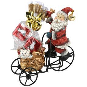 Weihnachtsmann auf Metallrad